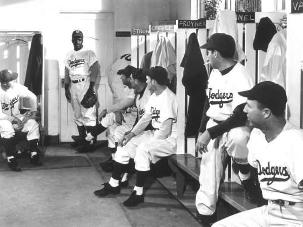 an analysis of the movie jackie robinson story Jackie robinson plays himself in this true story of the man who broke major league baseball's color barrier in 1928, jackie robinson, a young african-american boy who loves baseball, is given an old, worn out glove by a white man.