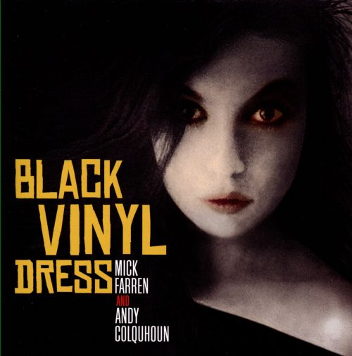 The Woman in the Black Vinyl Dress