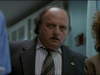 NYPD Blue: Cop in a Bottle