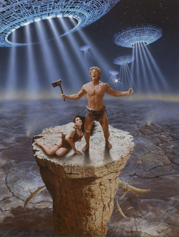 v con Yor sospeso su un precipizio con Kaala fra navi aliene in alto e pterodattili in basso.