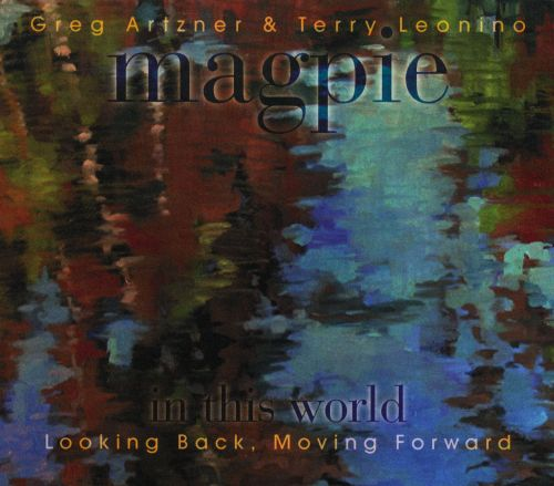 In This World: Looking Back, Moving Forward